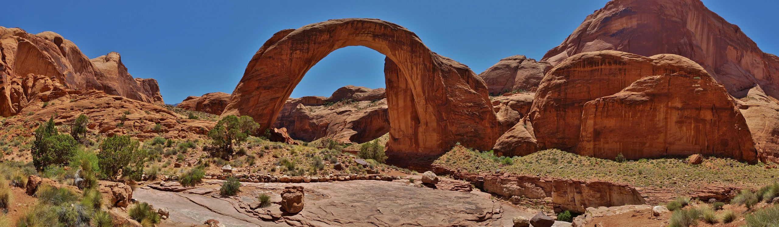 The span of Rainbow Bridge is approximately 290 ft tall, spans 275 ft and the top is 42 feet thick and 33 feet wide.