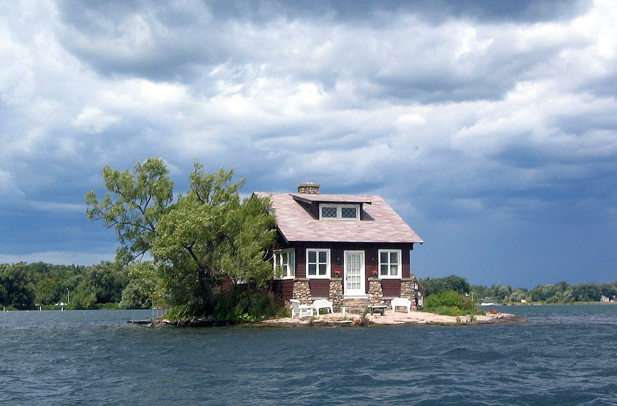 Just imagine in your dream, an island is with just enough room for a home, a beautiful greenish tree and A pair of bench chairs for the owners to lounge in the absorbing sun.