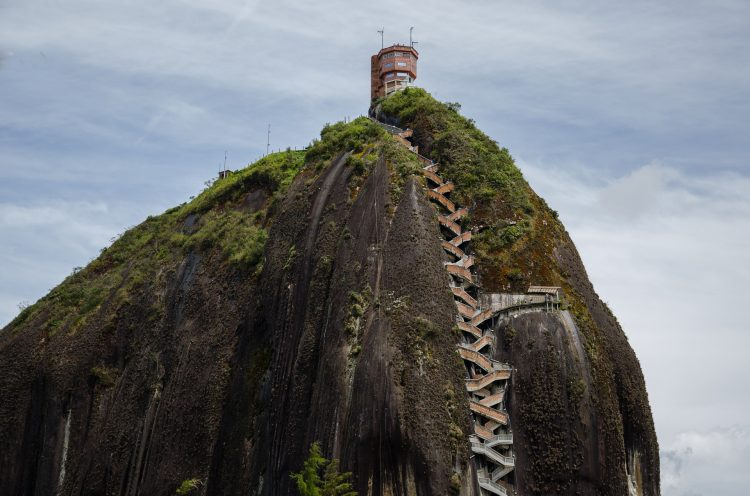 """The Rock of Guatape, is an iconic landmark inselberg also famous as """"The Stone of El Peñol"""" located in the border of two towns Guatapé, and El Peñol Antioquia in Colombia."""